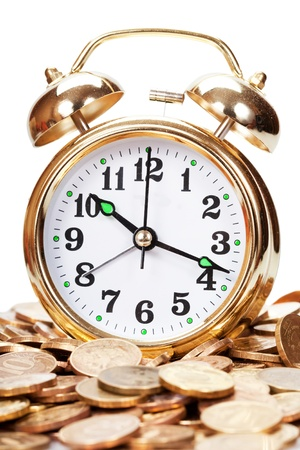 Great golden alarm clock faces on coins. Time is money photo