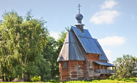 The traditional russian wooden church for tourists in the ancient town of Suzdal , Russia photo