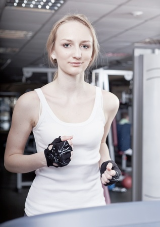 girl is engaged in a sports hall on a racetrack photo