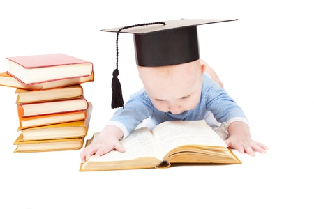 early childhood: kid in a hat of the bachelor and the book. Concept of early education