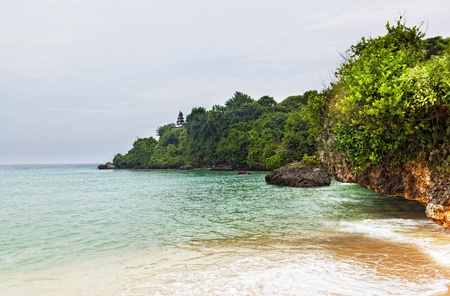 Tropical landscape with a sandy beach and rocks photo