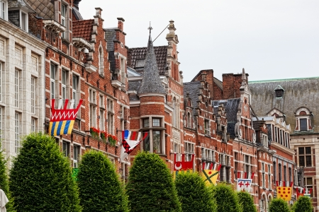 flemish: Bright flags on a wall of an ancient building, Leuven, Belgium