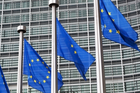 schengen: European Union flags against the European Parliament building