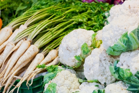 agronomics: Cauliflower and other vegetables on a counter in the market Stock Photo