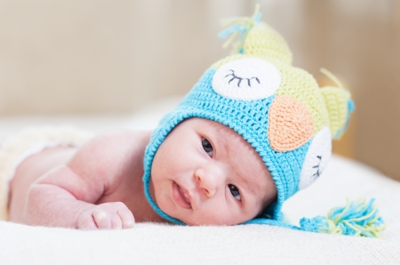 newborn baby in a bright knitted hat photo