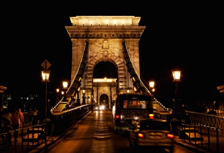 Chain bridge at night with cars  photo