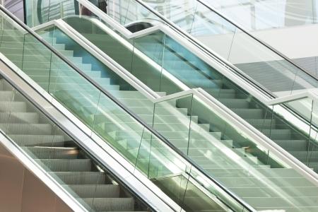 Two escalators in modern business center photo