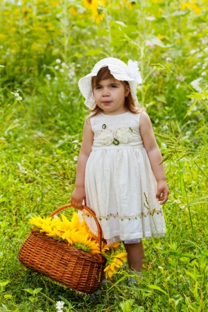 wattled: little girl with a big wattled basket with sunflowers