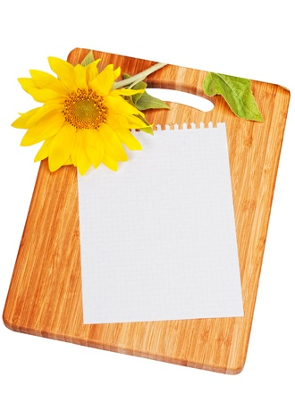Sheet of paper for record of recipes on a chopping board photo
