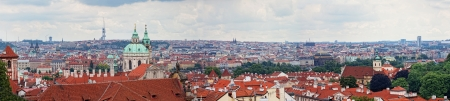 View of tile roofs in a historical part of Prague photo