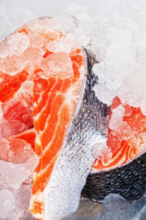 Two stakes from a salmon with ice close up photo