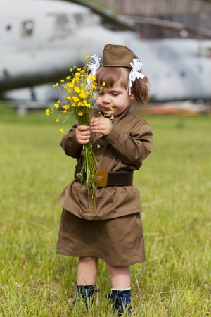 military uniform: little girl in a military uniform against planes  Stock Photo