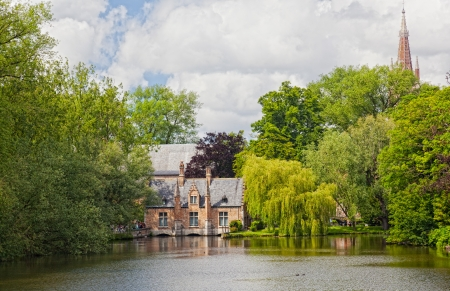 old brick house on the channel in Bruges in a sunny day. Belgium  Stock Photo - 15328028