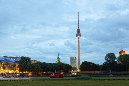 town halls: Evening view of a television tower in Berlin, Germany Stock Photo
