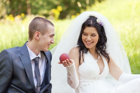 bride treats the groom with a ripe peach Stock Photo - 15636668