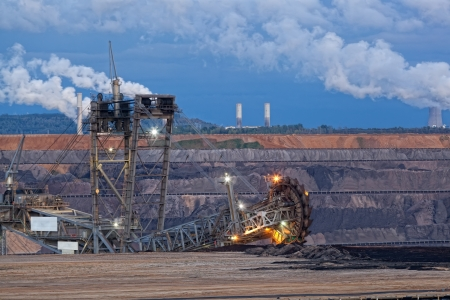 dragline: Bucket-wheel excavator in an open pit  landscape with extractive industry Stock Photo