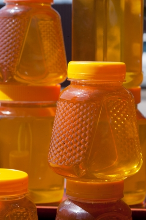 curative: Jugs with honey on a counter in the market