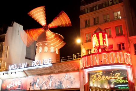 PARIS - OCT 2: The Moulin Rouge by night, on October 2, 2012 in Paris, France. Moulin Rouge is a famous cabaret built in 1889, locating in the Paris red-light district of Pigalle  Stock Photo - 15951249