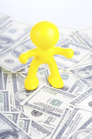 little yellow man to stand for dollar Stock Photo - 16660542