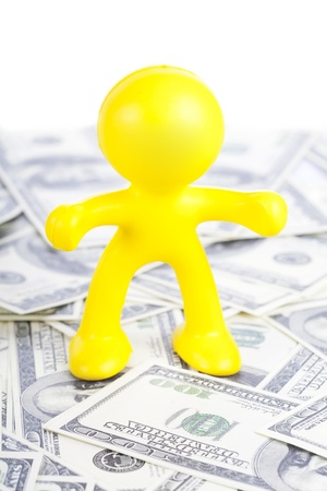 little yellow man to stand for dollar Stock Photo - 16660512