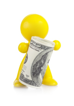 yellow little man holds the money curtailed by a roll Stock Photo - 16660503