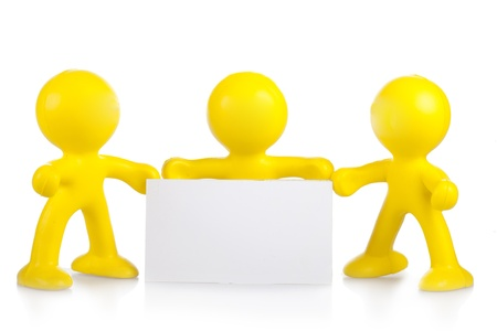 Three yellow little men hold a white banner with a place for the text Stock Photo - 16660509