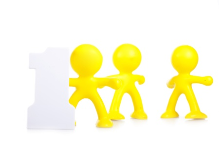 Three little men and figure 1, as leadership and victory symbol Stock Photo - 16660481