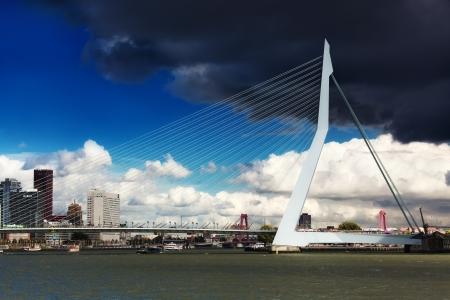maas: ROTTERDAM, NETHERLANDS - SEPTEMBER 28. Look Erasma Bridge to Rotterdam, Nideranda, September 28, 2012. Vantovy Bridge through the river Maas in the center of Rotterdam, the first from the sea.