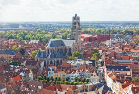 top view to Bruges and the cathedral St. Sauveur, the oldest brick church of Belgium photo