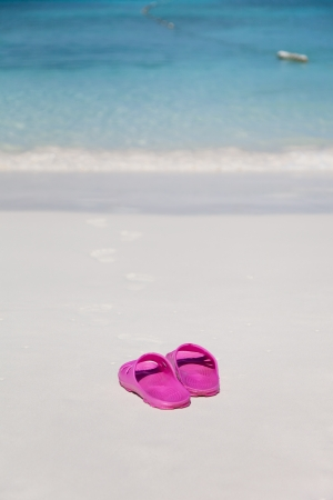 sandles: Pink beach bedroom-slippers and traces on sand Stock Photo