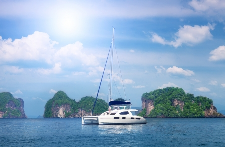 white beautiful yacht against rocks. Thailand photo