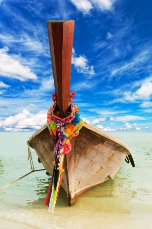 Longtail, the traditional Thai boat, against the blue sky with beautiful clouds photo