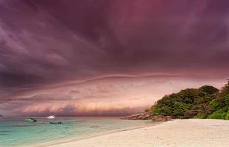 Sandy beach at sunset before a thunder-storm, Thailand photo