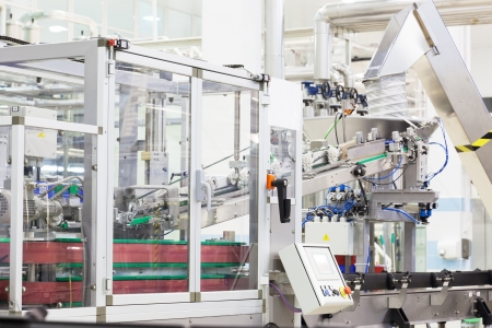 conveyors: Modern industrial shop on pouring mineral water