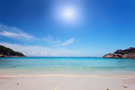 Scenic sand beach under bright blue sky, Similian Islands, Thailand photo