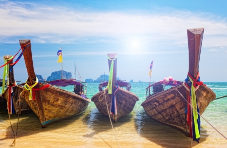 Traditional longtail boats in Railay beach, Thailand photo