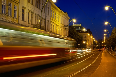 tram on the evening street of Prague photo