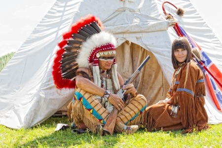 native american girl: Group of North American Indians about a wigwam