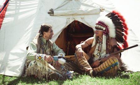 swarty: North American Indians sit at a wigwam