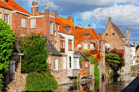 Classic view of channels of Bruges. Belgium. Medieval fairytale city. Summer urban photo