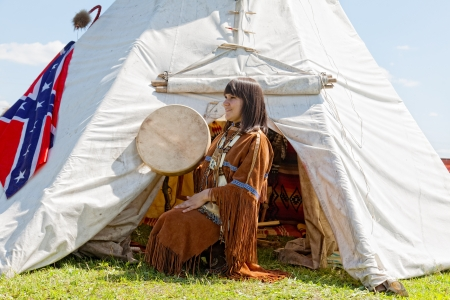 swarty: North American Indian girl in full dress  Reconstruction Stock Photo