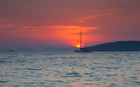 Big yacht against a sunset  Thailand photo
