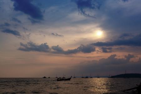 aonang: Longtail boats against a sunset. Ao-Nang, Thailand. Stock Photo