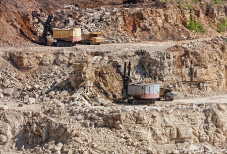 Big trucks and excavators work in career on mining Stock Photo - 21723170