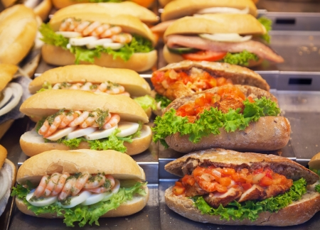 Various sandwiches on a shop counter photo