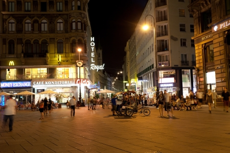 VIENNA, AUSTRIA - JULY 27  Tourists on a central square, Vienna, Austria, July 27, 2013  Every year to Vienna there come about 6,5 million tourists