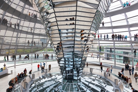 BERLIN, GERMANY - SEPTEMBER 24 Tourists under Reichstag dome, September 24, 2012, Berlin, Germany  After moving of the Bundestag to Berlin in 1999 the building of the Reichstag was visited by over 13 million people from all over the world