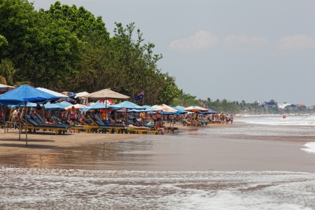 vacationers: BALI, INDONESIA, MARCH 12: Vacationers on a beach, Bali, Indonesia, March 12, 2012. Bali � a heavenly spot in the Indian Ocean; the brightest decoration of the Indonesian archipelago