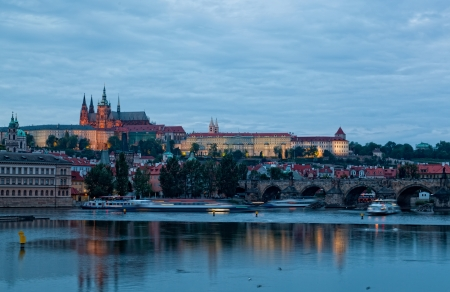 Night view of Prague - river Vltava, Gradchany, St. Vituss cathedral photo
