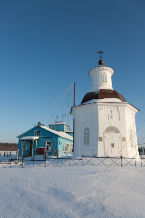 wooden building of the airport and chapel on the Solovki in the winter photo
